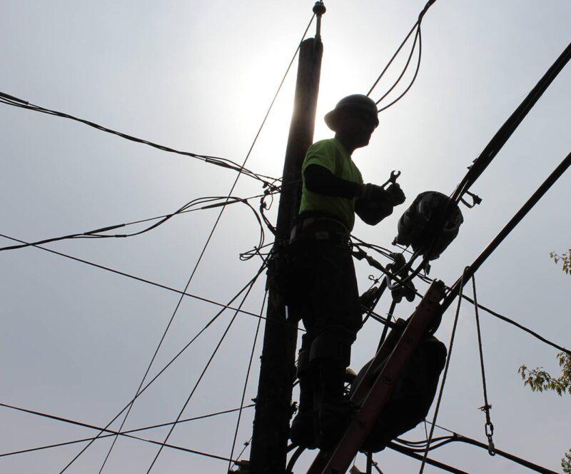 Man on Electric Pole